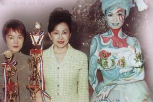 黄建瓴在97第二十一届亚洲发型化妆大赛获幻彩化妆组冠军